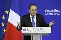 France's Hollande makes bold debut on EU summit stage