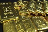 Gold hits 2-week high as U.S. data weighs on dollar