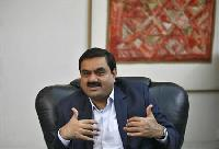 Adani to hike stake in power subsidiary to 75%