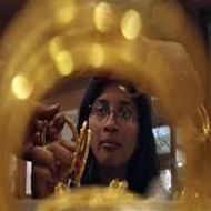 Gold loses Rs 155, silver sheds Rs 700 on weak global cues