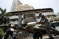 BSE Sensex falls; rupee hits record low