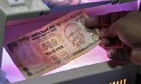 Rupee gains; awaits Greece, RBI outcome