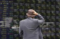 Asian markets shrug off risk, may regret it