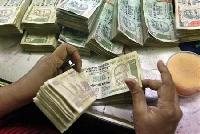 Rupee at day's high; shares rise