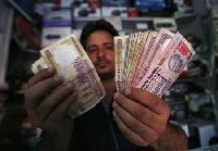 Rupee at day's low on oil demand