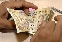 Rupee rises from session low on euro gains