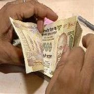 Rupee hits all-time low of 54.46/dollar on capital outflow