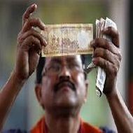 Rupee edges up; hopes for fuel price hikes help