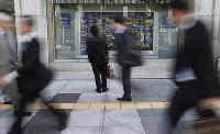 Asian shares held back by weak Japan GDP, US fiscal cliff