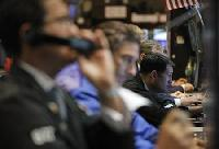 Wall Street opens lower as stimulus hopes dim