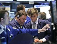 Wall Street gains on Spain hopes, Apple hits new peak