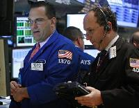 Wall Street little changed in thin trade after mixed data