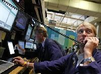 Diminished Fed stimulus hopes send global shares lower