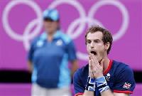 Gold, not tears, this time for Murray