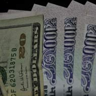 Rupee gains on share sale inflows; trade deficit weighs