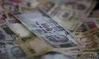 Rupee slump costly for &#36;5.5bn in convertible bonds