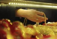 Gold recovers from 4-1/2-month low as euro firms