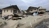 US Northeast cleans up from storm Sandy, death toll up