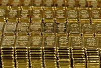 Gold holds near two-week highs