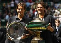 Haas shocks Federer to win battle of over-30s