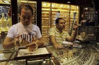 Gold hits 4-month high on Fed stimulus hopes, Spain