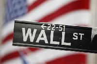 Wall St falls as techs warn on profits