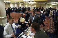 US jobless claims fall, trade gap widens