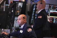 Wall Street opens higher after jobs data, Draghi