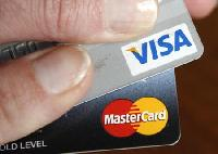 Visa, MasterCard edging closer to fee pact: Report