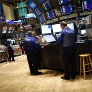 Wall Street ends up slightly on data; HP drags