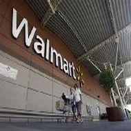 Wal-Mart India unit suspends CFO, others