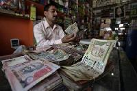 Rupee edges higher; oil buying likely to limit gains
