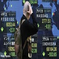 Nikkei falls, weighed by exporters as yen firms