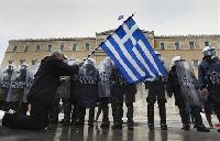 Greece drafts bailout text for parties as talks inch ahead
