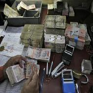 Rupee in range; no RBI action spotted