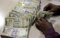 Rupee falls on inflow uncertainty, importer demand