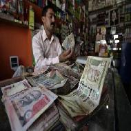 Rupee falls as risk-taking fades, RBI watched